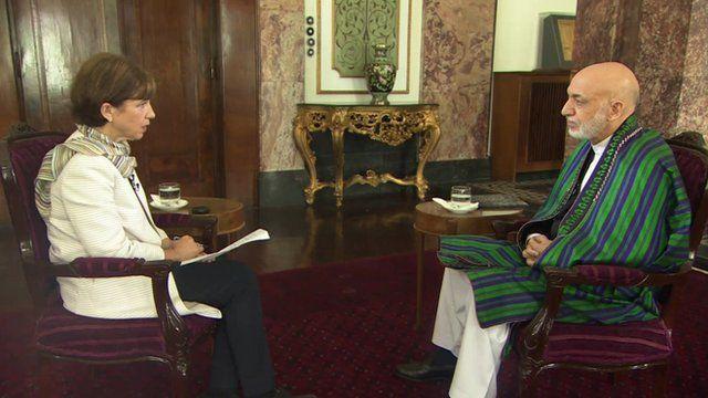 Lyse Douset speaking to Hamid Karzai