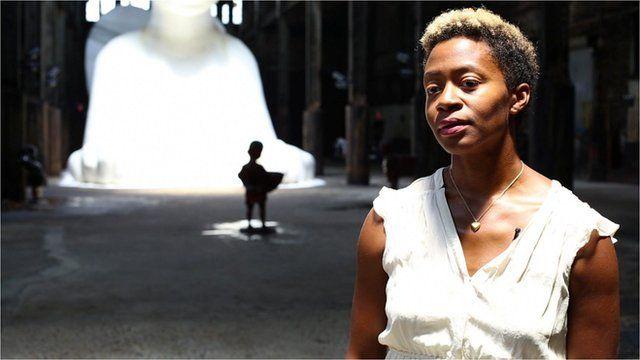 Kara Walker in front of her sugar sculpture