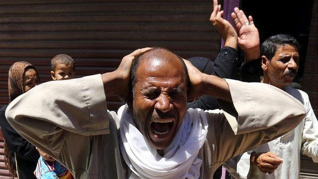 Relatives of Muslim Brotherhood members and supporters of Mohamed Mursi react outside court