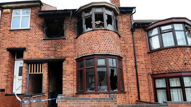 File photo dated 15/09/13 of a general view of the scene of the fatal house fire in Wood Hill