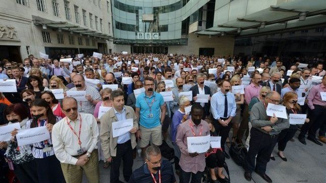 BBC journalists in London join colleagues from other news organisations for a silent protest outside New Broadcasting House