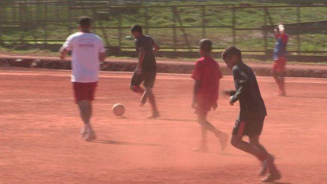Brazilian children playing football