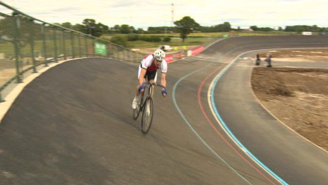Man cycling on outdoor velodrome