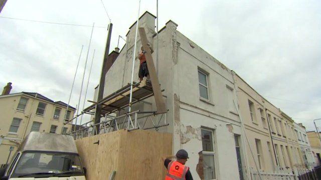 The covered scene of the Banksy artwork in Cheltenham