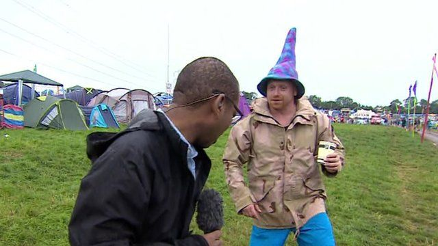 The BBC's Lizo Mzimba talks with a Glastonbury reveller