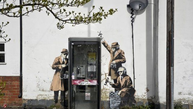 "The Banksy mural ""Spy Booth"""
