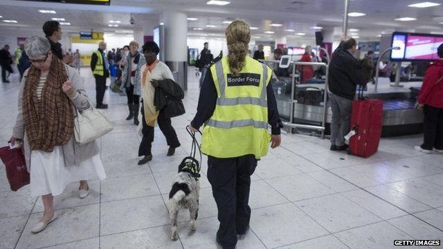 Border Force worker and sniffer dog