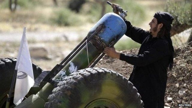 A Free Syrian Army fighter loading a weapon