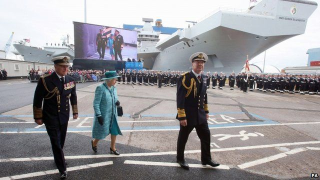 Queen Elizabeth II and the Duke of Edinbugh and HMS Queen Elizabeth