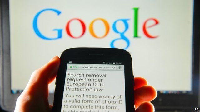 A Google search removal request displayed on the screen of a smart phone