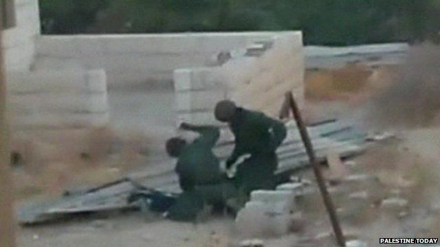 Amateur footage of two policemen apparently beating boy