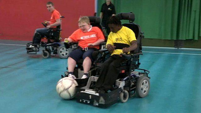 Children playing powerchair football