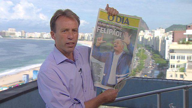 Ben Brown holding newspaper