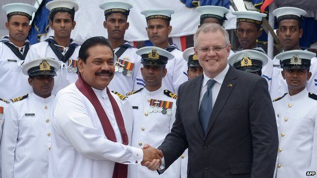 "Sri Lankan President Mahinda Rajapakse (L) shakes hands with Australia""s immigration minister Scott Morrison"