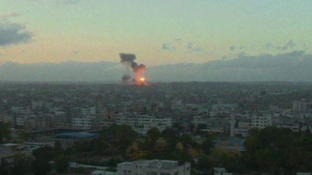 Gaza skyline with explosions