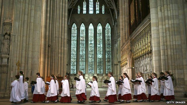 The choir process through York Minster during a Eucharist Service attended by the Church of England Synod
