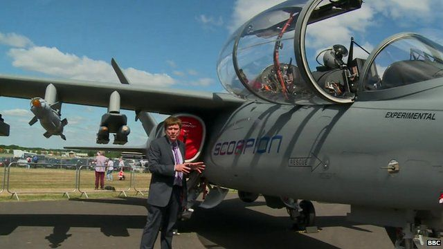 The BBC's Nigel Cassidy next to a Scorpion fighter jet at Farnborough Airshow