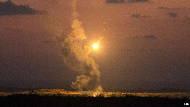 View from southern Israeli Gaza border showing Israeli army flares falling into the Palestinian enclave, July 14, 2014