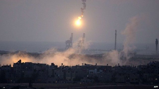 View from southern Israeli-Gaza border showing Israeli army flares falling into the Palestinian enclave, July 15, 2014
