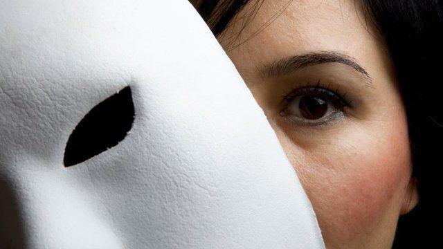 Woman holding mask