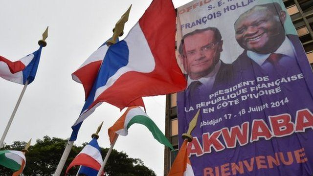 A poster of the French and Ivory Coast presidents