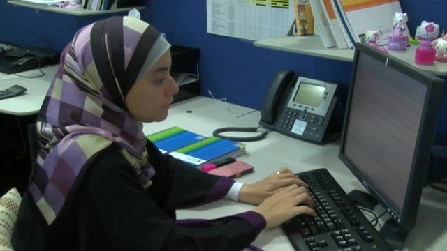 Islamic bank employee typing