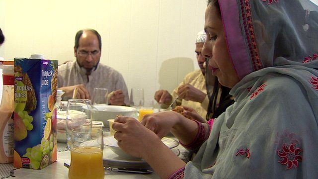 A family in Norway having a meal during Ramadan
