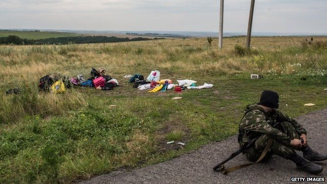 Separatist fighter at scene of MH17 crash