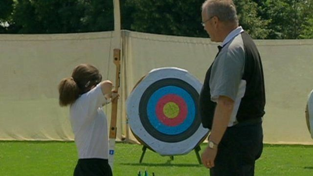 Child taking part in archery session