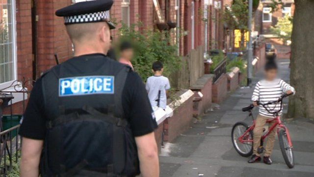 Police officer on patrol in Oldham