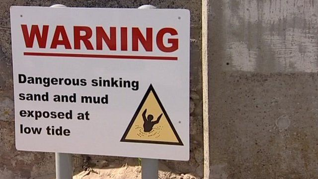 Warning sign from the beach at Burnham-on-Sea about sinking mud