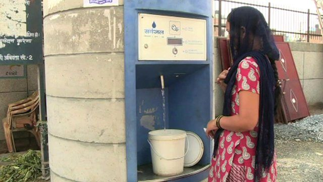 Woman at water ATM
