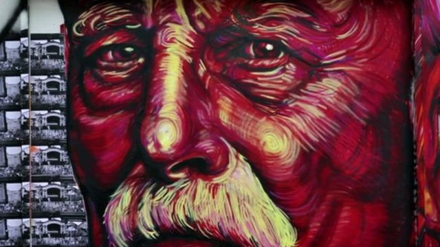 Graffiti painting of an old man's face