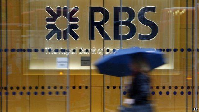 Woman walks past RBS branch