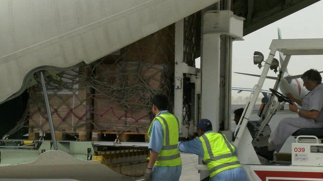 Aid packages loaded into plane