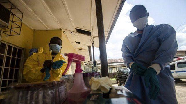 Medics wear protective gear at Sierra Leone hospital