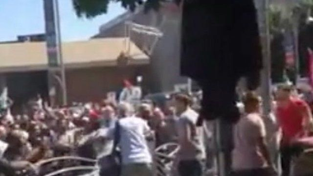 A bar stool is thrown during the violence in video. Video posted by Ian James