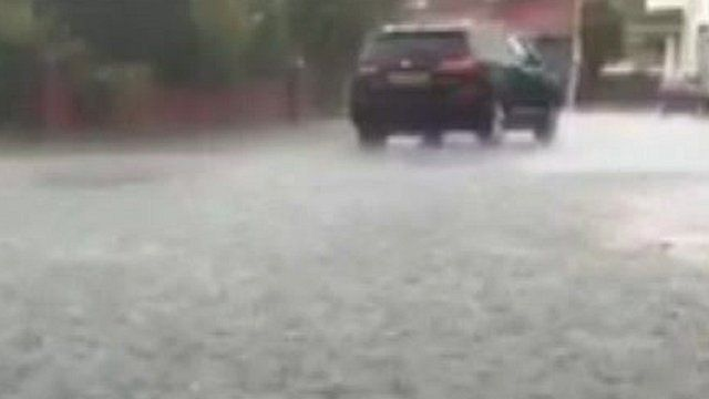 Car in flooded road