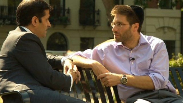Asad Ahmad (left) with Rabbi Natan Levy