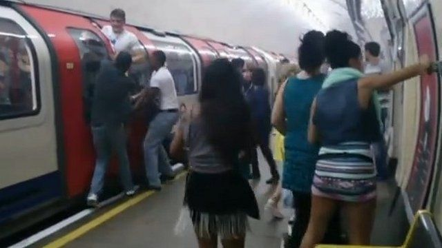 Passengers on the Central line Tube at Holland Park
