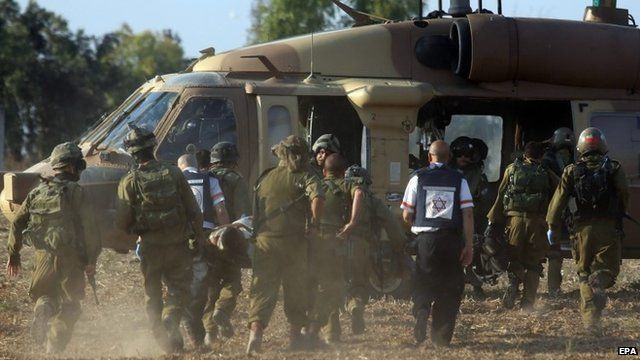 Israeli soldiers evacuate a wounded soldier