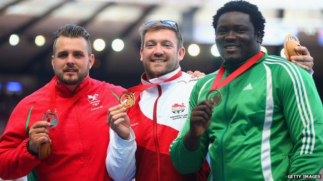Silver medallist Aled Davies of Wales, gold medallist Dan Greaves of England and bronze medallist Richard Okigbazi of Nigeria in the F42/F44 discus at Glasgow 2014