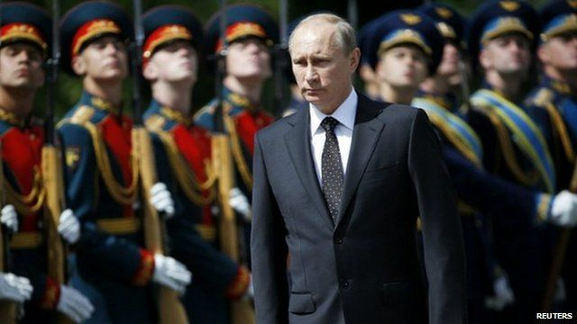 Russian President Vladimir Putin attends a ceremony to commemorate the anniversary of the beginning of the Great Patriotic War against Nazi Germany in 1941 in Moscow - 22 June 2014