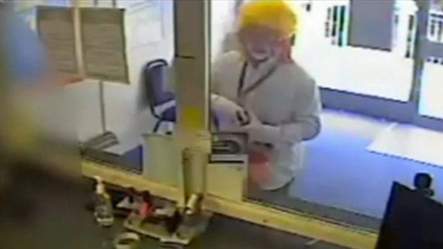Man dressed as a clown robbing a currency exchange