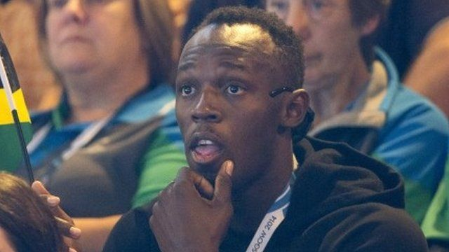 Usain Bolt watches netball at the Commonwealth Games