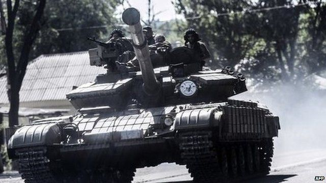 Pro-Russian militants sit on a tank in Donetsk, eastern Ukraine