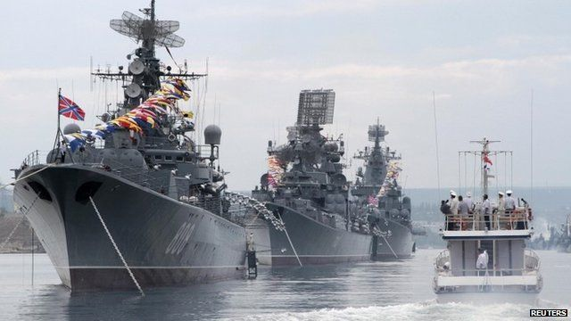 Russian warships are seen during a naval parade rehearsal in the Crimean port of Sevastopol, July 25, 2014