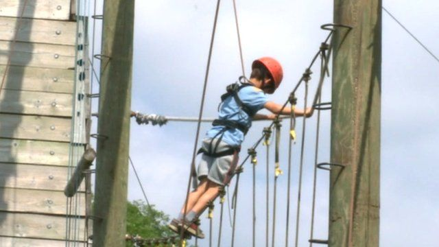 A child visits a climbing attraction