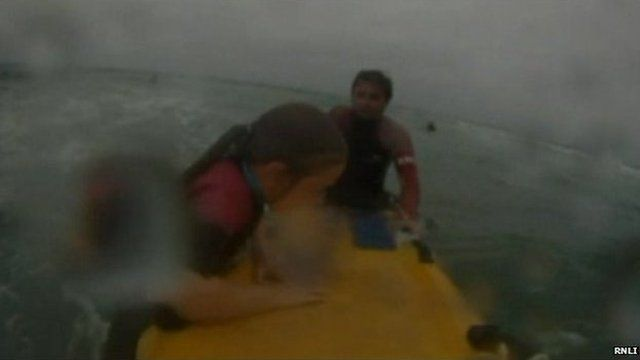 RNLI rescue girl in rip current