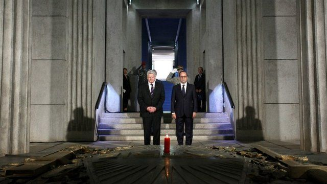 French President Francois Hollande (R) and German President Joachim Gauck visit the crypt at the memorial to the battles at Hartmannswillerkopf, as part of commemorations marking the centenary of World War I on August 3, 2014 near Cernay, France